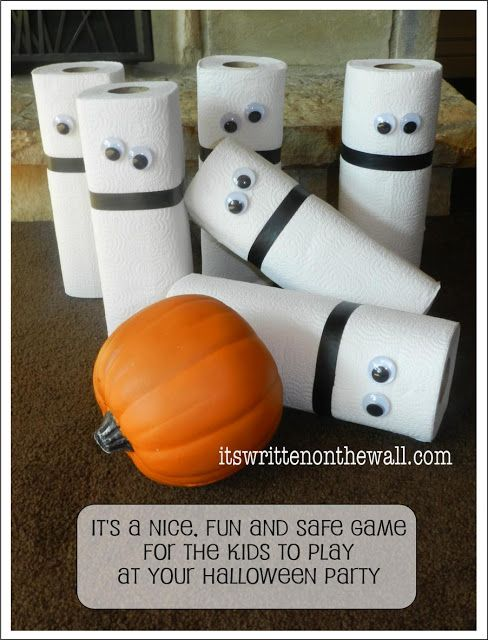 Easy set up Halloween party activity bowling with a pumpkin and paper towels