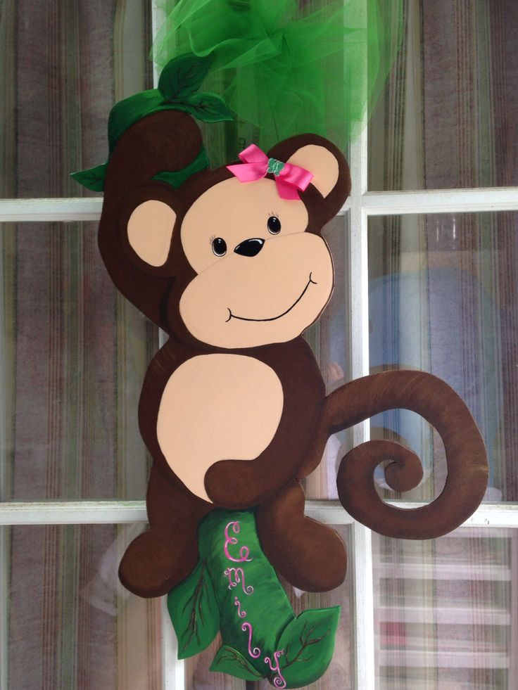 Hand painted wood monkey. Can be placed on mesh wreath. Can be personalized. Painted Burlap leaves can be added for demensional look and to hold birth information.
