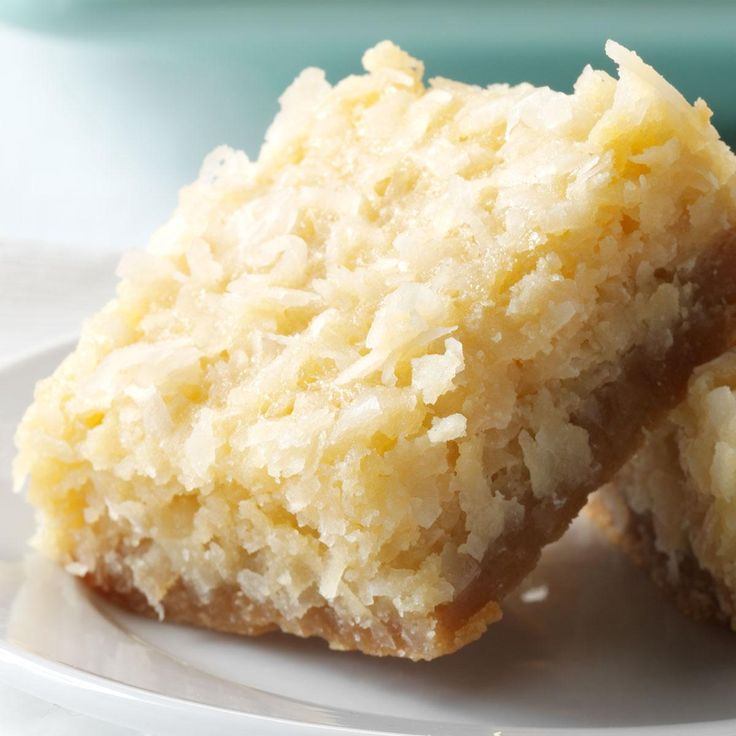 Buttery Coconut Bars Recipe -My coconut bars are an American version of a Filipino coconut cake called bibingka. These are a crispier, sweeter take on the Christmas tradition I grew up liking. —Denise Nyland, Panama City, FL