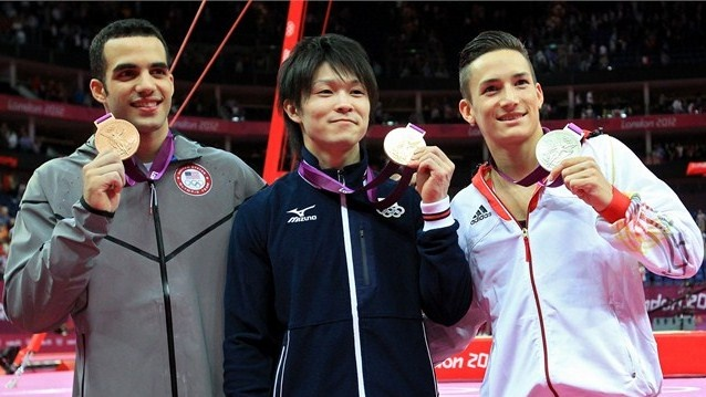 Gold medalist Kohei Uchimura (C) of Japan, silver medalist Marcel Nguyen (R) of Germany and bronze medalist Danell Leyva of the United States of America pose during the medal ceremont for the Artistic Gymnastics Men's Individual All-Around final on Day 5