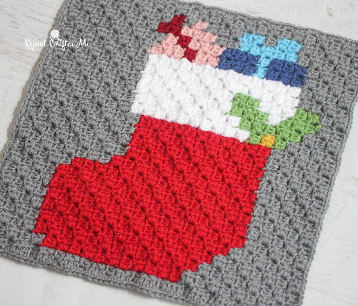 Here it is! The last square in the Crochet Christmas Character Afghan!! The Christmas Stocking (complete with presents sticking out of the top), is another iconic image that couldn't be left out of the blanket. But check back in the next couple days for a bonus square and links to some other Christmas pixel square ideas …