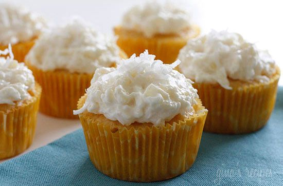 Pina Colada Cupcakes - Bake these tropical piña colada cupcakes as a way to escape from the cold January weather!
