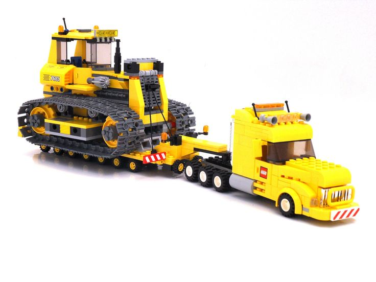 Selfmade heavy truck with custom trailer. Carrying a standard LEGO 7685 bulldozer.