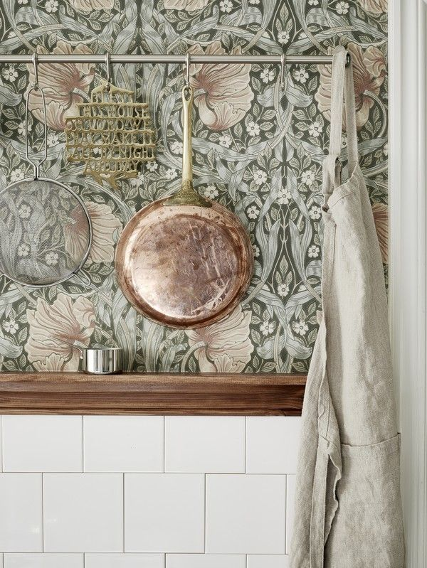 loving the william morris wallpaper with the copper and brass. This could make a really nice kitchen.