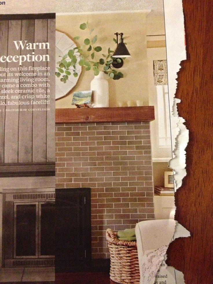 matte subway tiled fireplace with a rustic wood mantel