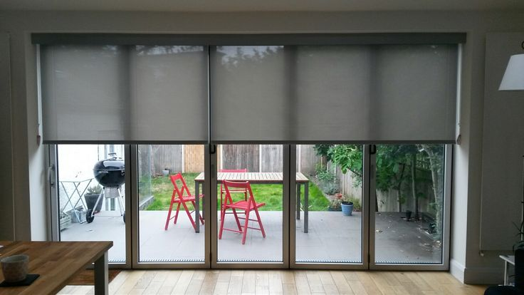 Blfold door blinds. Specialist screen fabrics cover huge areas by Deans Blinds And Awnings. #bifold #door #blinds