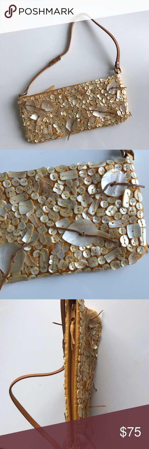 Chan Luu mother of pearl baguette bag. Chan Luu mother of pearl shell bag. Shells are sewn on, multiple sizes. No missing shells! Orange gold color silk bag with yellow gold mother of pearl shells. Tan leather strap. Zipper closure. Baguette shape. Perfect condition. Never used. Chan Luu Bags Mini Bags
