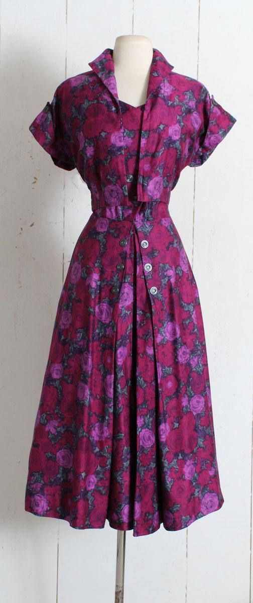 """➳ Vintage 1950s Dress Gorgeous brushed cotton rose print dress in shades of purple. Button front, metal side zipper, subtle pleating at front of skirt, matching bolero jacket. Excellent condition - no flaws. Fits like L. Length 49"""" Bodice 19"""" Bust 40"""" Waist 29-30"""" 2 bodice"""