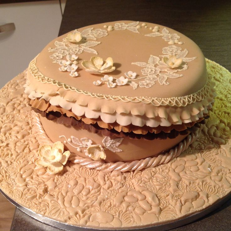 Garret frills, and brush embroidery cake in coffee and creams
