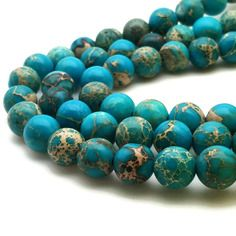 50 perles régalite 4mm bleu clair naturelles - perle régalite perles jaspe aqua terra jaspe sédiment