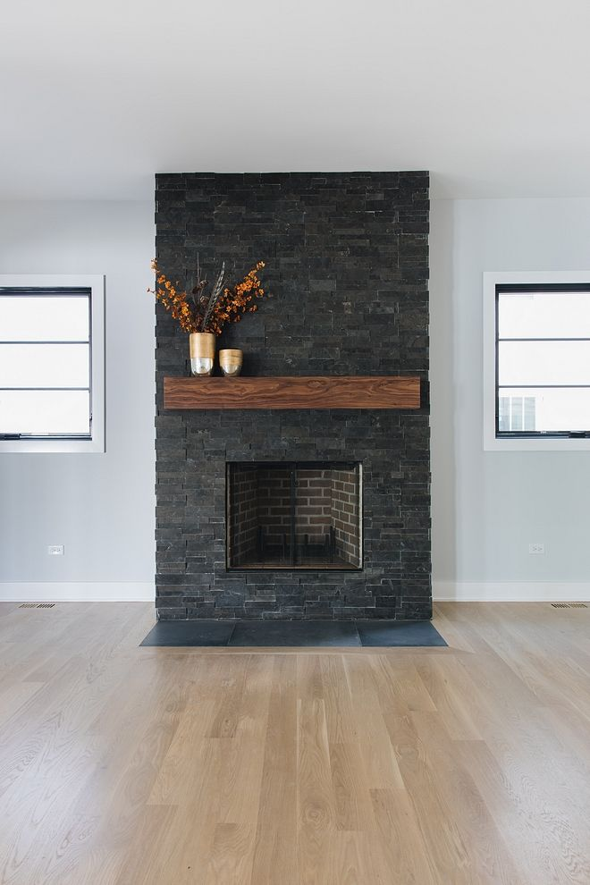 Dark Stone Fireplace Flanked Black Windows This