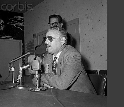 Original caption: Carlos Prio Socarras, former president of Cuba, pictured at a press conference 5/10 (night) in which he explained why and how he had to leave Cuba or else. Photo taken at the Biscayne Terrace hotel 5/10 during the press conference. Miami, Florida, USA (photo: Bettmann/CORBIS), May 10, 1956. For information about Cuban History of this period please visit Cuba 1952-1959