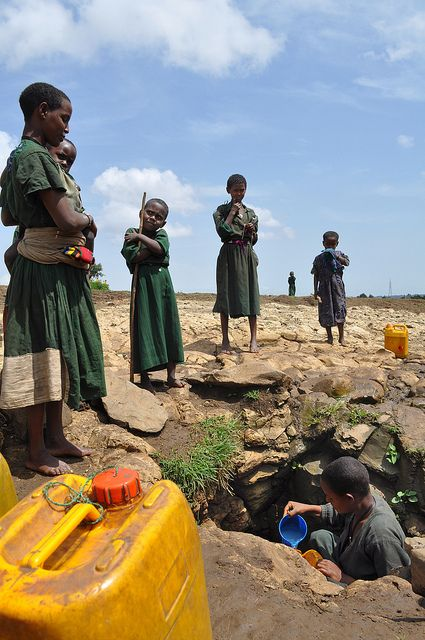 Girls in Telasa, Ethiopia, wait their turn at an unprotected water source.