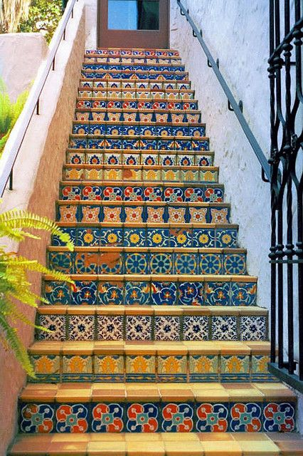 Tiled risers on staircases make them less of a chore to climb. *Use this idea for our patio steps*