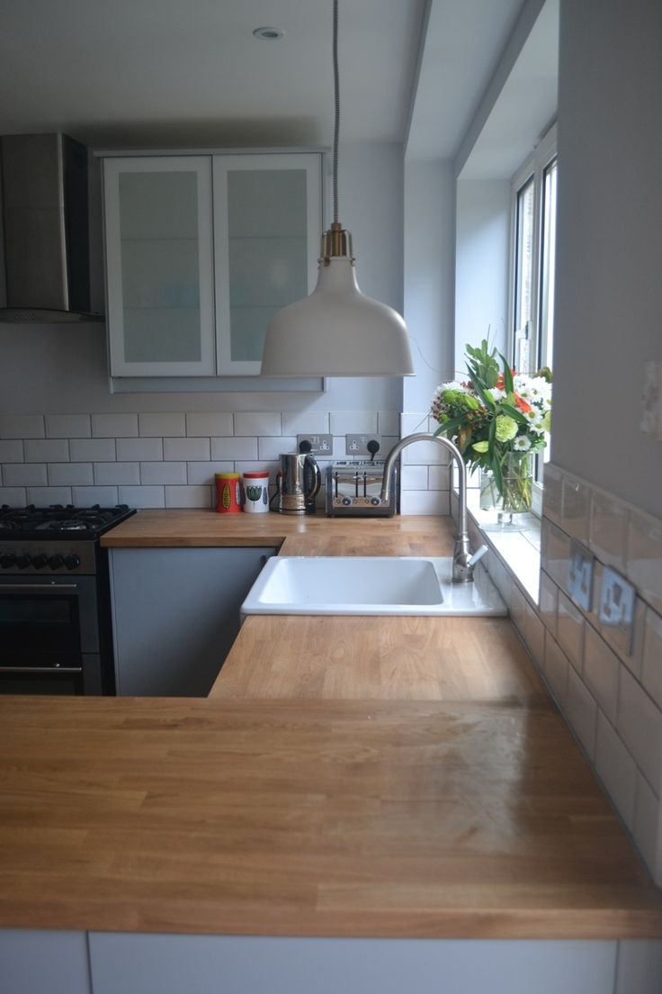 My completely renovated kitchen with Ikea Veddinge grey fronts, Karlby worktop, Domsjo sink and Ranarp pendant lights.  See more from my home renovation at: www.angelinthenorth.com