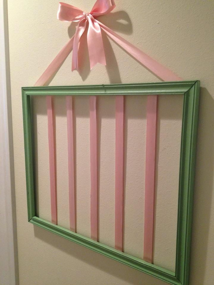 Bow or Hair Clip Holder - from an empty picture frame with ribbon stretched across the back.   For cheer bows, choose paint & ribbon in team colors.  (Link to article is broken.)  -LRE