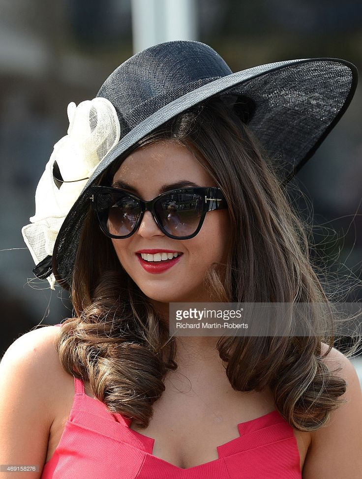 Lady enjoys the atmosphere on Day 2 of the Aintree races at Aintree Racecourse on April 10 2015...