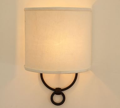 Francis Sconce from Pottery Barn. Also comes in polished nickel, though I like the rustic black.