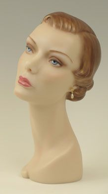 This is a REPLICA of a 1940's department store display bust that was molded directly from a vintage model. This was probably the most widely sold hat model of the 40's and 50's
