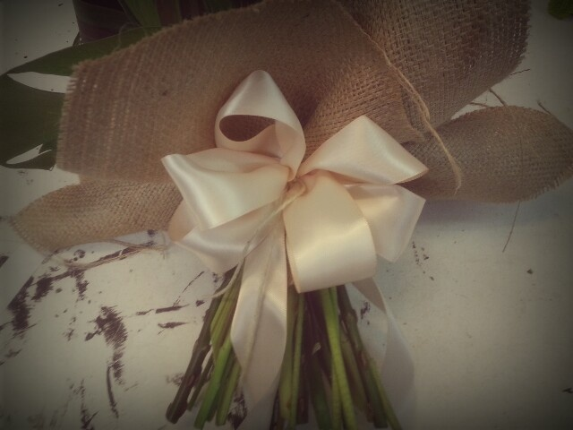 Step 6) bow making - now you should be ready to secure the bow to the posy by attaching it to the natural twine you used to bind the hessian wrap in place