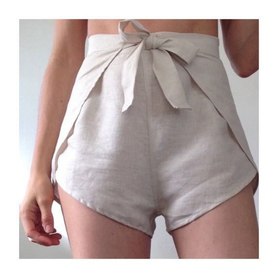Linen wrap shorts. High-waist wrap style shorts with waist tie and high-cut leg. Model is XS and wears size XS. Colors: Black Pale Beige (sold out)  Sizes: XS (Ladies 2-4) Waist 25-26 Hips up to 38  S (Ladies 6-8) Waist 27-28 Hips up to 40  M (Ladies 10-12) Waist 29-30 Hips up to 42  L (Ladies 14-16) Waist 31-32 Hips up to 45  Material: 100% linen. Linen is a natural fiber from the flax plant. Washed Linen is a light-medium weight linen that is pre-washed. Its very soft and durable.  Washing…