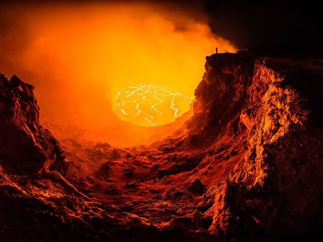 Stunning selfie of a lone man facing a terrifying volcano pit