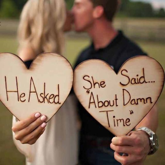She said About damn time Engagement photo prop
