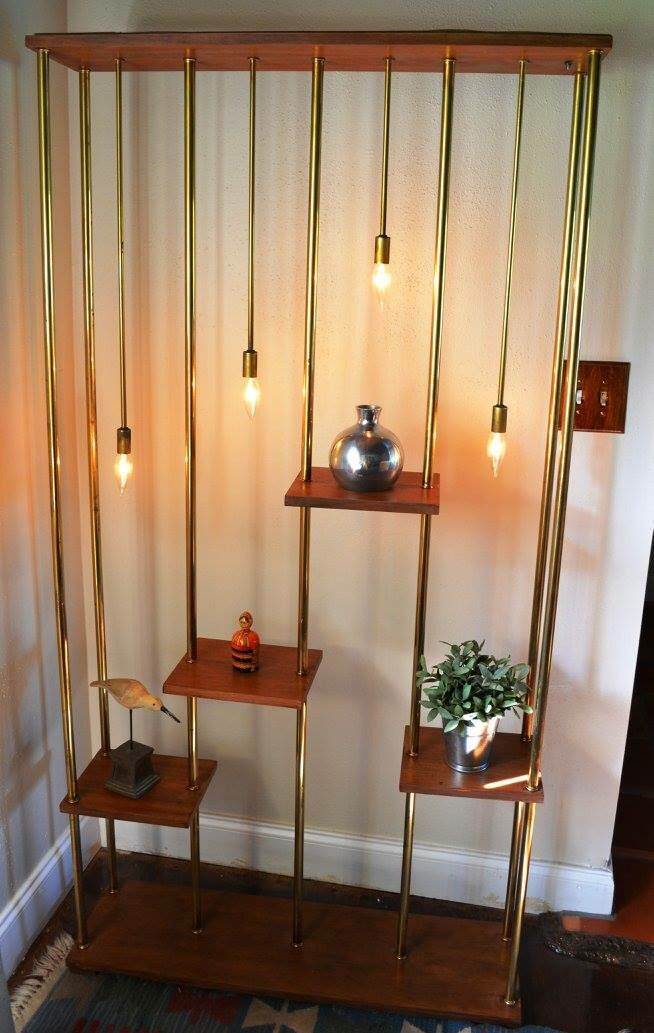 Retro mid-century room dividing lighted display shelves.