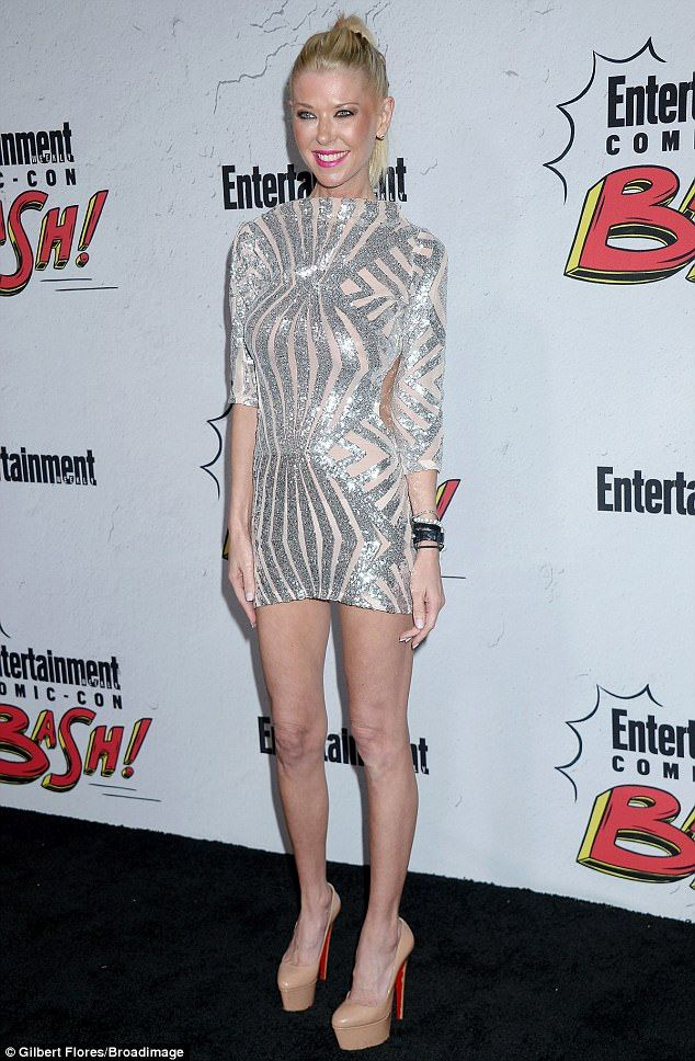 Beaming: Tara Reid's draped her slender frame in a gleaming silver and nude mini-dress for the Entertainment Weekly Party at San Diego Comic-Con