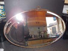 Espejo Vintage Vidrio Biselado Ovalado con una envolvente de bronce 67x43cm