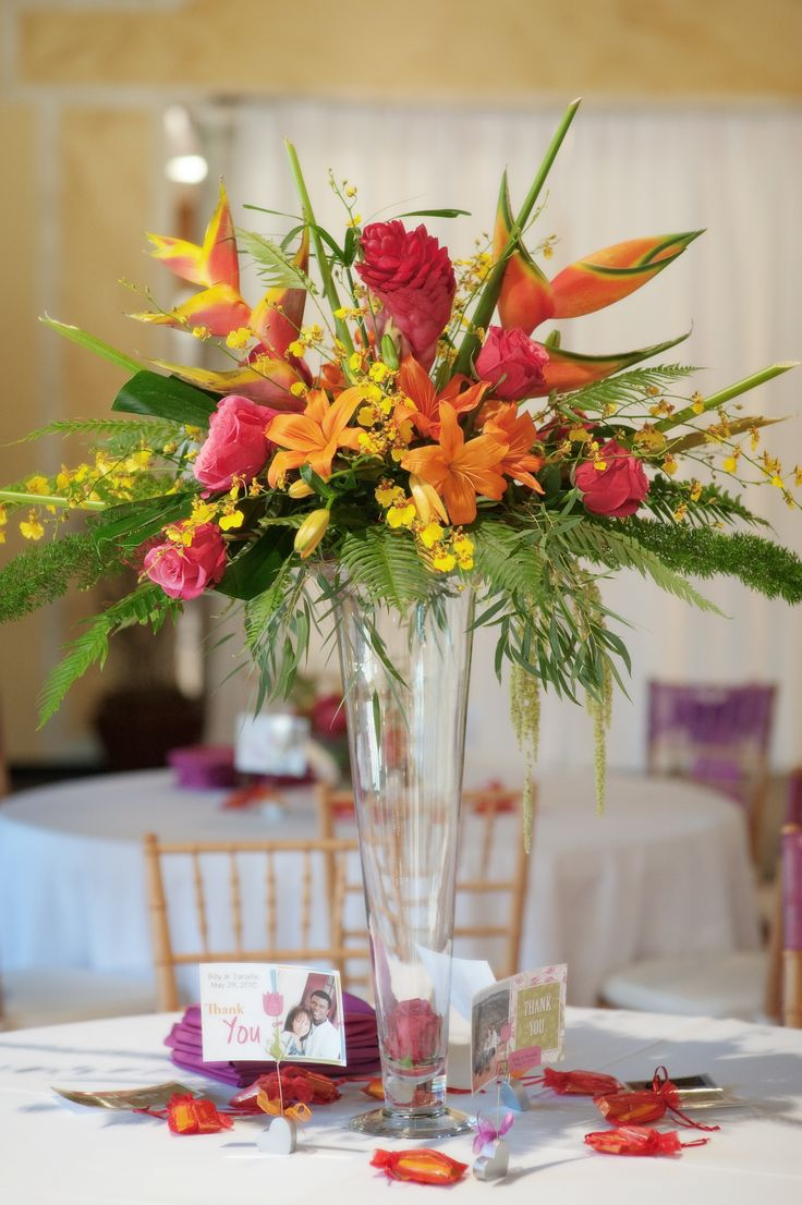 Best 25 tropical centerpieces ideas on pinterest luau for Floral arrangements for wedding reception centerpieces