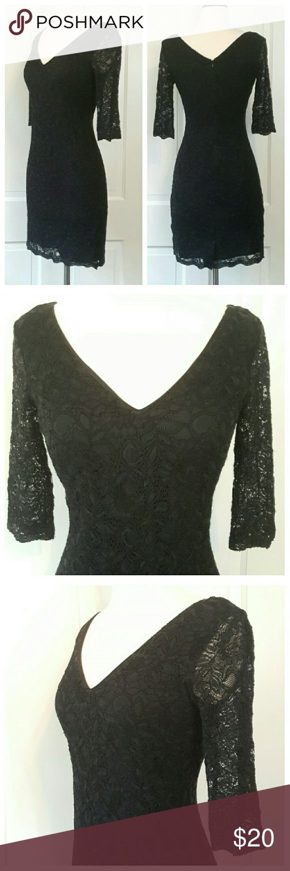 Banana Republic Navy Lace Dress Dress has lace overlay on body and sheer lace on 3/4 length sleeves. V back and front, back zipper. Some of the lower lace area is less defined than others, see last picture. Dress appears to be black in pictures, but is a elegant dark navy. Banana Republic Dresses