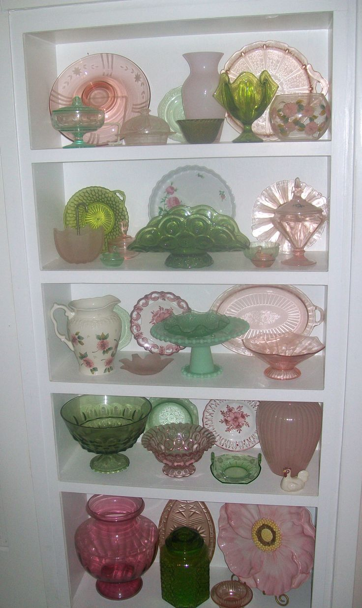 Green and pink depression glass...now THIS is my kind of depression glass display!! Love the mix & match of colors and styles!