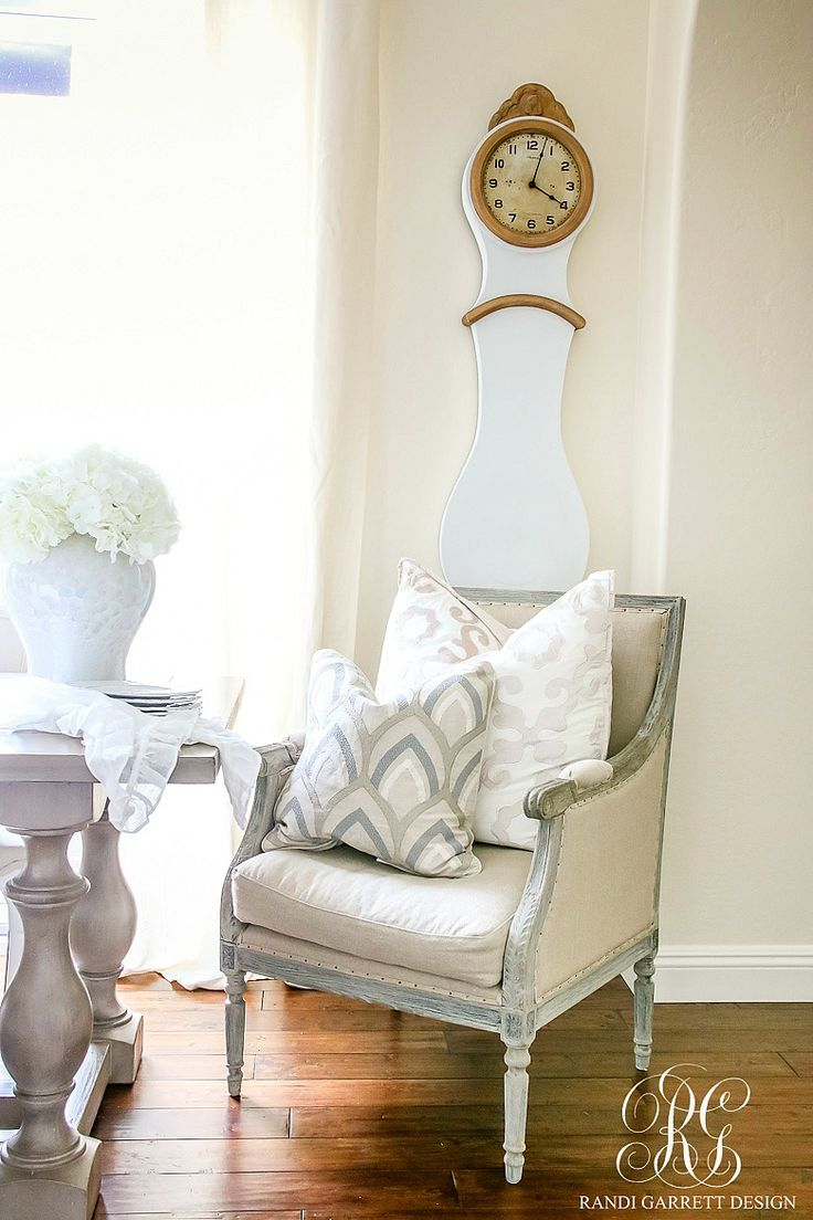 Captain's chair at dining table in kitchen with French mora clock wall version. Soothing Summer Home Tour 2017 - Neutral Transitional Home Decor