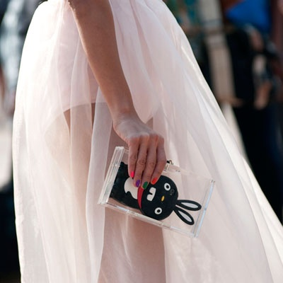 Bunny phone in a Lucite Lux® clutch, Cute. Milan 2013 - Spring Fashion Week Street Style - Marie Claire