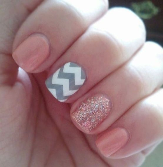 Pink nails with sparkly pink nail accent and chevron nail accent