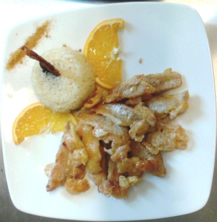 Filetti di pesce persico dorati alle mandorle con riso in cagnone
