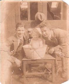 There's something about Irish language names – both first names and last names – that people the world over find compelling. Useful resource page of Irish names, meanings, and history. [picture:Sean and Seamus Ó Dubhghaill (aka John and James Doyle) bathing their little cousin Sean O'Geanin (John Gannon)]