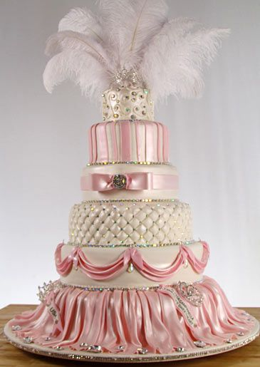 Pink and white cake with feathers