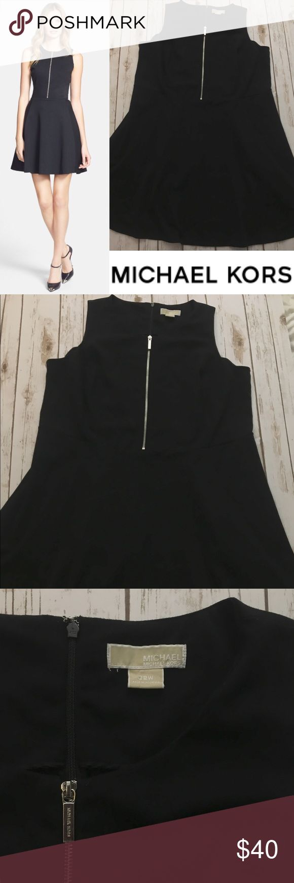 MICHAEL MICHAEL KORS Dress This gorgeous fit and flair dress by Michael KORS is perfect for any occasion. This piece can be layered with a blazer for the office, a denim jacket and flats for a casual event and strappy heels for a night out! Size 22. MICHAEL Michael Kors Dresses
