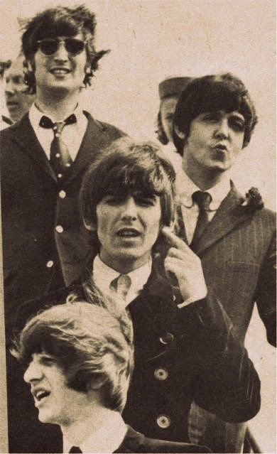 :The Beatles as they arrived in NYC for the first time...too many screaming girls.  Were you one of those?