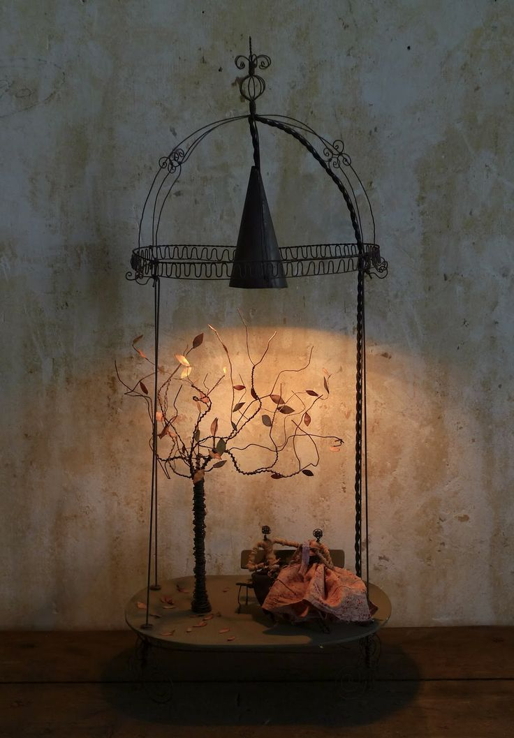 Miniature lamp cage with tiny vignette inside by pascale palun vox populi featured in making magic in the south of france my french country home by
