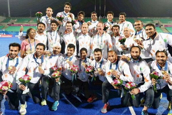 Photo - Day 13 action @ Asian Games  Gold medal winning Indian team poses for a photograph after medal ceremony of men's hockey at the 17th Asian Games.