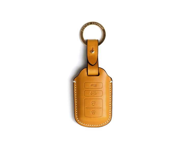 KIA the new k7,k9 Handmade Buttero Leather Smart Key Cover/Case   -Handmade by: Custom Republic  -Leather: Vegetable leather from Conceria Walpier & Vera Pelle -Attachment pieces: 18K gold satin coating - Colors: natural, yellow, orange, brown, navy, and camouflage -Thread & Stitching: Serafil (from Germany)  -Measurement: 5.8cm x 15cm