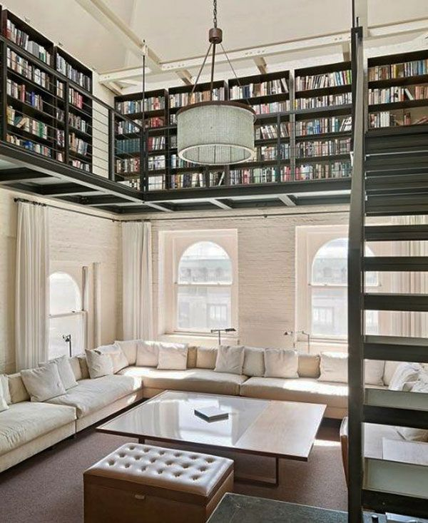 Loft-style library and modern styling. Loving the contrast of the light furniture colors with the dark wood of the shelving.