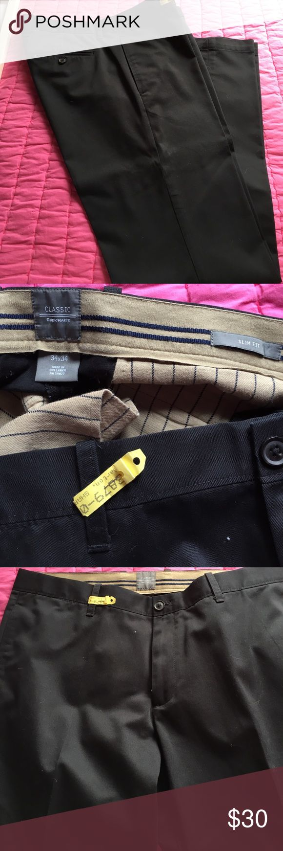 Gap men's khaki pants Gap men's  black flat front khaki pants . Size 34-34 slim fit .style Sj757376-01 E classic slim khaki chino black  v1204 .These pants have only been worn twice and are in excellent condition and dry cleaned . GAP Pants Chinos & Khakis