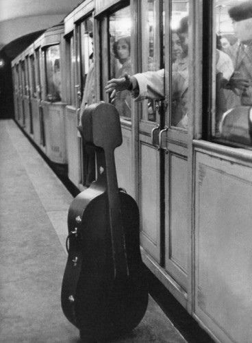 Robert Doisneau, Paris photographer: European subway passenger reaching out almost closed door for forgotten cello? RESEARCH by DdO:) http://www.pinterest.com/claxtonw/4-5-6-strings/ - Musical instrument on 4 5 6 STRINGS Pinterest Music Board, with guitars, violins, harps, etc stringed instruments. Excellent interest black & white vintage photography. Doisneau, French photographer in 1930s on, & Henri Cartier-Bresson were pioneers of photojournalism.