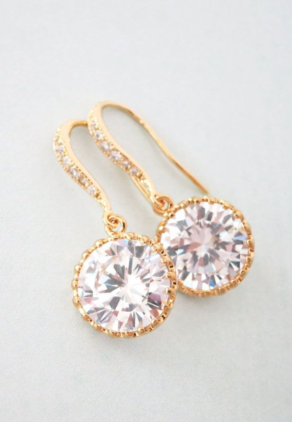 Beautiful pair of earrings is made of gold finished ear wire with 13mm Clear Round Cubic Zirconia Crystal. More sparkling in person. High quality gold finished.