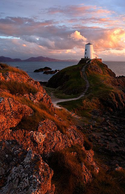Students tour to North Wales & Snowdonia.. Llanddwyn lighthouse in evening light, North Wales