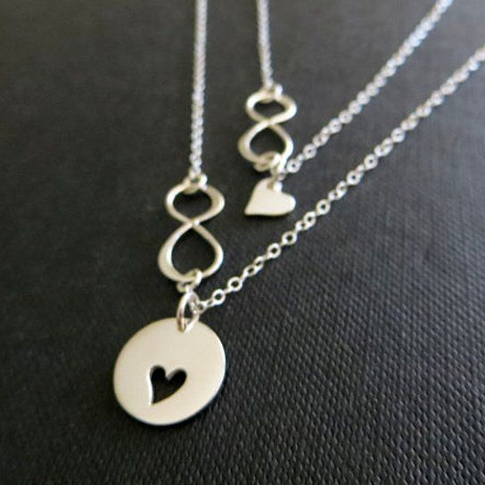 Set of 2 infinity necklace for mother and daughterOur updated version of mother daughter necklaces now with infinity link. Two separate necklaces featuring sterling silver cut out heart disc for mother and tiny heart charm for daughter. 925 sterling silver fine chain.tiny heart-7mmheart cutout disc-13mm